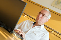 Web search. Searching the web on laptop during working hours stock photography