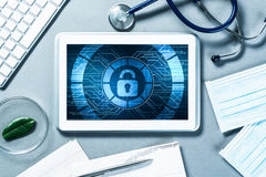 Web security and technology concept with tablet pc on table Royalty Free Stock Image