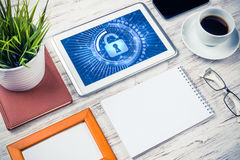 Web security and technology concept with tablet pc on wooden tab Royalty Free Stock Photography