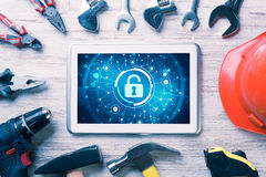 Web security and technology concept with tablet pc on wooden tab Royalty Free Stock Photos