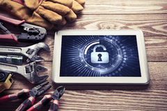 Web security and technology concept with tablet pc on wooden tab Stock Photos