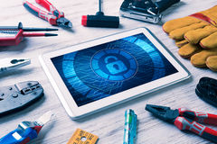 Web security and technology concept with tablet pc on wooden tab Stock Image