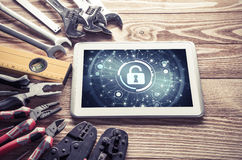Web security and technology concept with tablet pc on wooden tab Stock Photo