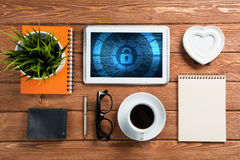 Web security and technology concept with tablet pc on wooden table Royalty Free Stock Photography