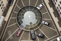 Web-shaped car parking. Around glass dome in the courtyard Royalty Free Stock Photography
