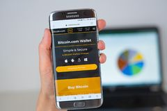 Web site of Bitcoin company on phone screen royalty free stock photos