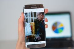 Web site of Royal Family on phone screen stock images
