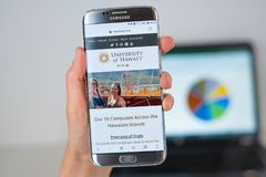 Web site of University of Hawaii on phone screen. Barcelona / Spain 06 10 2019: University of Hawaii web site on mobile phone screen. Mobile version of royalty free stock image