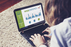 Web statistics in a laptop computer screen. Woman analyzing web Royalty Free Stock Images