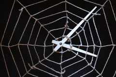 Web For Time. Conceptual background with web made from rope and clock hands on dark royalty free stock photography
