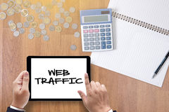 WEB TRAFFIC (business, technology, internet and networking concept ). A finance Money, calculator notes, calculator top view work stock image