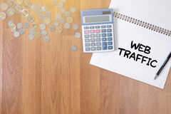 WEB TRAFFIC (business, technology, internet and networking concept ). A finance Money, calculator notes, calculator top view work stock photos