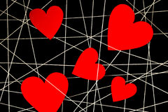 Web of white threads with red heart Stock Image