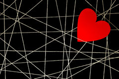 Web of white threads with red heart Stock Images