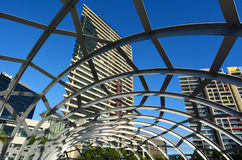Webb Bridge - Melbourne. MELBOURNE,AUS - APR 14 2014:Webb Bridge against towers of Yarra's Edge at Docklands in Melbourne, Australia.It's a residential precinct Royalty Free Stock Photography