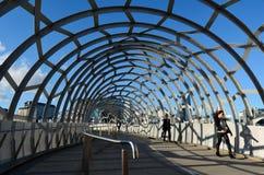 Webb Bridge - Melbourne. MELBOURNE,AUS - APR 14 2014:Pedestrians cross on Webb Bridge.It's an award winning bridge forming a cycling and pedestrian link to the Stock Images