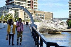 Webb Bridge - Melbourne. MELBOURNE,AUS - APR 14 2014:Visitors cross on Webb Bridge.It's an award winning bridge forming a cycling and pedestrian link to the main Royalty Free Stock Images