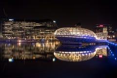 Webb bridge with modern building bakground reflecting on Yarra r Stock Photo
