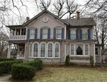 Webb House. This is a Winter picture of the John Webb House on a cloudy day located in Elgin, Illinois in Kane County. This two story wood framed house is an royalty free stock image