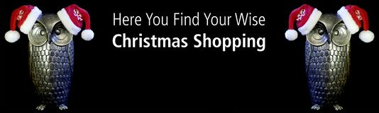 Be Wise. Owls with text Here you find your Wise Christmas shopping. Black background stock images