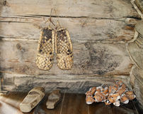 Webbed Russian old bast shoes on the wooden background Stock Photos