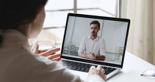 Female employee making video call talking with executive manager