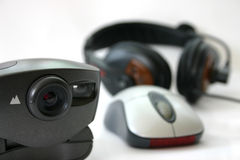 Webcam chat. Webcam mouse and mic. Using shallow depth. Focus on webcam royalty free stock photography