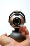 Webcam op een hand stock afbeelding