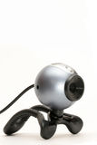 Webcam vertical. Webcam with usb cable, closeup over white and limited depth of field Stock Photos