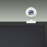 Webcam of white plastic standing on the monitor. Stock Photo