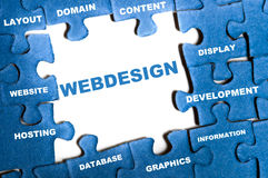 Webdesign puzzle. Webdesign blue puzzle pieces assembled Stock Image