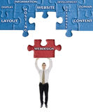 Webdesign word on puzzle in man hands Royalty Free Stock Photo