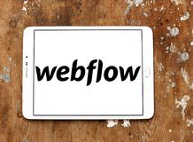 Webflow software company logo. Logo of Webflow software company on samsung tablet. Webflow is a professional drag and drop tool built for designing websites stock photos