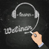 Webinar chalk on a blackboard, 3d hand and Royalty Free Stock Photos