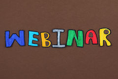 Webinar. Colorful paper cut out word Webinar Stock Photos