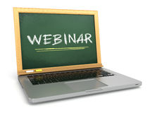 Webinar concept. Laptop with chalkboard and chalk. Royalty Free Stock Photography