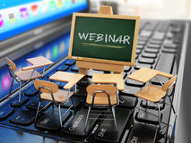 Webinar concept. Schooldesk and chalkboard on the laptop keyboar. D. 3d Stock Image