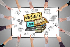 Webinar concept on a whiteboard. Hands pointing to webinar concept royalty free stock photos