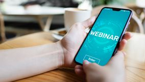 Webinar E-learning Online Training Coaching Education concept on mobile phone screen. stock photos