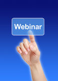 Webinar. Hand press the button with the word webinar royalty free stock image
