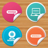 Webinar icons. Web camera and notebook pc signs. Stock Photography
