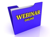 Webinar Online bright yellow letters on a blue folder Stock Photo