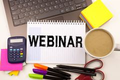 Webinar text in the office with surroundings such as laptop, marker, pen, stationery, coffee. Business concept for Online Training Stock Photo