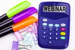 Webinar text in the office with surroundings such as marker, pen writing on calculator. Business concept for Online Training Devel Royalty Free Stock Photography