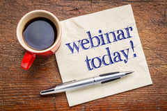 Webinar today reminder on napkin. Webinar today reminder - handwriting on a napkin with cup[ of coffee royalty free stock photos