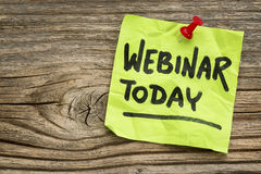 Webinar today reminder note. Webinar today reminder - handwriting on a green sticky note against grained and knotted wood board royalty free stock images