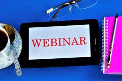 Free Webinar — Web Conference, Online Meetings Or Presentations Over The Internet At The Computer. A Computer Tablet, Reading Glasses Royalty Free Stock Photo - 161267805