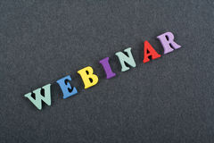 WEBINAR word on black board background composed from colorful abc alphabet block wooden letters, copy space for ad text Stock Image