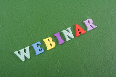 WEBINAR word on green background composed from colorful abc alphabet block wooden letters, copy space for ad text Royalty Free Stock Image