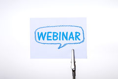 Webinar word writing on white paper note with Silver Business Ca Royalty Free Stock Photography